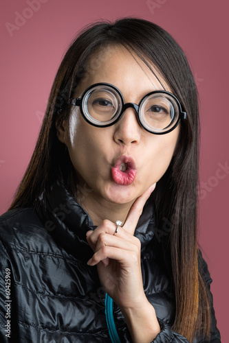 Woman with funny face over red background