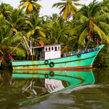 Indian fishing-boat with beautiful reflection in the water