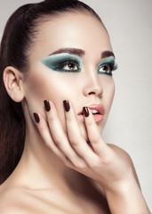 portrait of beautiful girl with smokey eyes makeup