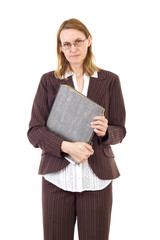 Serious businesswoman holding ring binder with old documents
