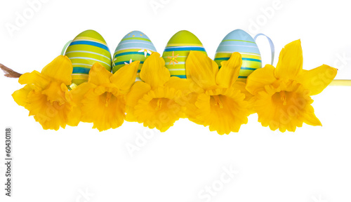 Isolated Easter Eggs Behind a Row of Yellow Daffodil Flowers