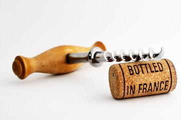 vintage corkscrew and wine cork with inscription bottled in Fran