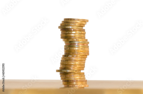 A stack of coins, isolated on white background