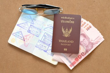 Thailand passport and Thai money