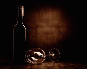 Rew wine bottle and glass