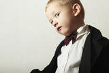 Funny Little Boy in Bow tie.4 Years Old Child in Black Suit