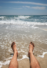 male legs on the beach