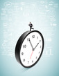 businessman runing on clock
