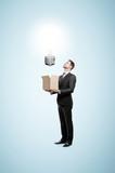 businessman holding box