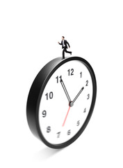 businessman runing on clock