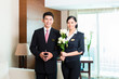 Asian Chinese hotel manager welcoming VIP guests