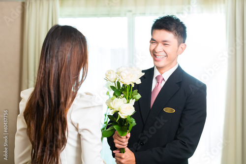 Asian Chinese hotel manager welcoming VIP guest