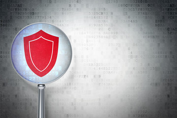 Privacy concept: Shield with optical glass on digital background