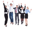 Group Of Businesspeople Raising Hands