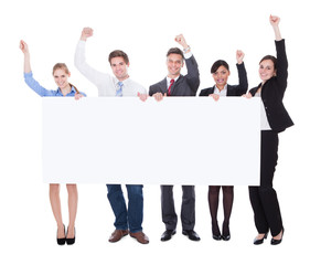 Businesspeople Raising Hand With Board