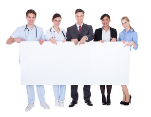 Doctors And Businesspeople With Billboard