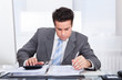 Young Businessman Working At Desk