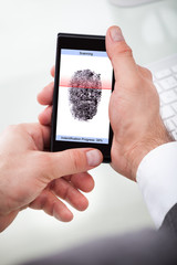 Businessman Holding Cellphone Scanning Finger