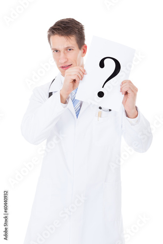 Doctor Holding Question Mark Sign