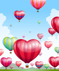 Heart shaped hot air balloons taking off