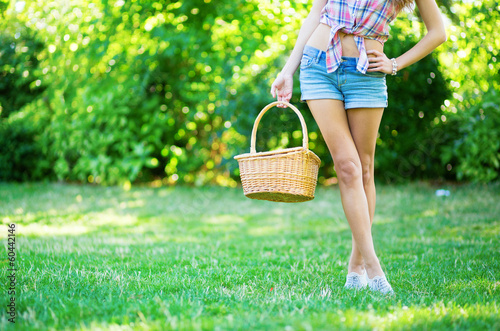 Young girl holding picnic basket
