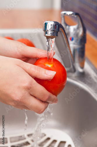 Woman Washing Tomato In Running Water Under Tap