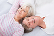 Senior Couple Lying On Bed