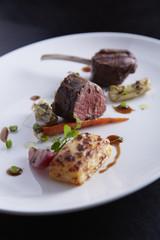 Lamp steak on white plate