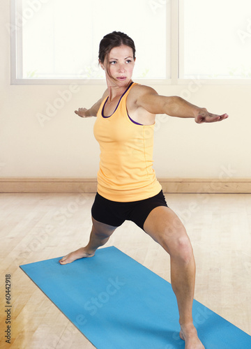 Fit Female stretching and doing yoga