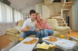 couple at home eating  pizza