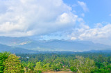 View from the top of Borobudur of lust green forest & extinct vo poster