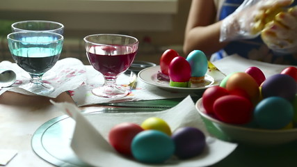 Two women coloring easter eggs.