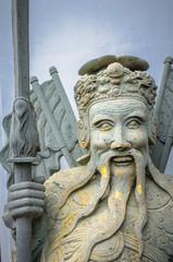 Chinese stone statue in Wat Pho, Bangkok, Thailand.Chinese stone