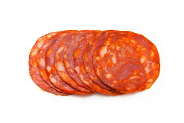 Sliced chorizo sausage isolated on a white studio background.