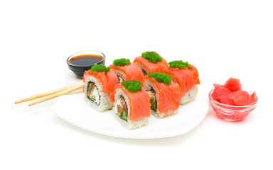 sushi, pickled ginger and soy sauce on a white background