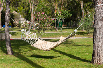 An empty hammock outdoors