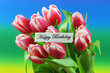 Happy birthday card with pink tulips on colorful background