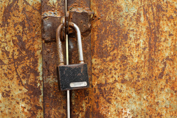 rusty lock on a metal gate background