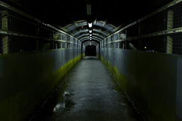 Dark tunnel on a rainy wet night