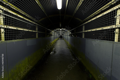 Dark tunnel partially lit on a rainy night