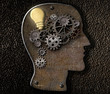Brain mechanism made from metal cogs and gear with idea bulb lam
