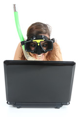Snorkel woman websurfing in a netbook computer