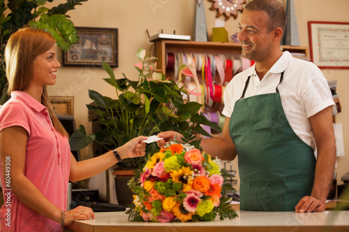 Woman is buying a colorful bouquet of flowers