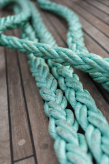 Green rope on ship deck