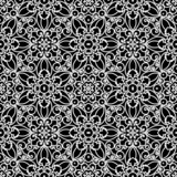 White lace ornament on black, seamless pattern