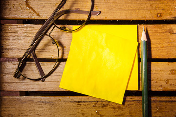 yellow blank paper  with glasses and pencil