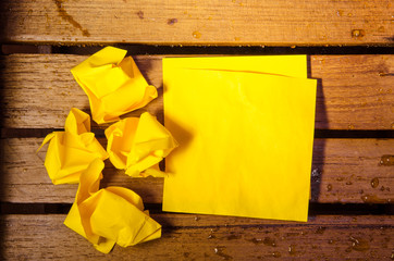 yellow blank paper with crumpled paper