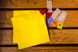 Yellow blank paper with love alphabet and small heart