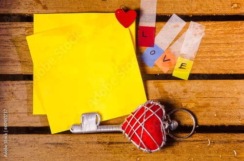 yellow blank paper with love alphabet with red heart key