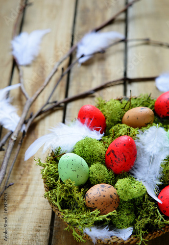 spring branch and basket with eggs - 60452153